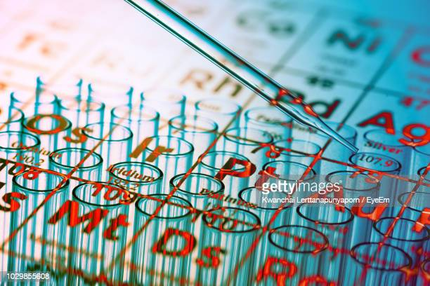 digital composite image of periodic table and test tubes - eye test chart foto e immagini stock
