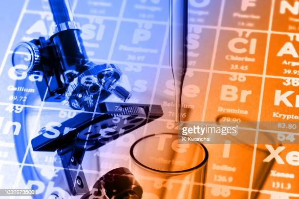 digital composite image of periodic table over microscope - eye test chart foto e immagini stock