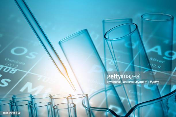 digital composite image of periodic table over pipette and test tube - periodic table stock photos and pictures