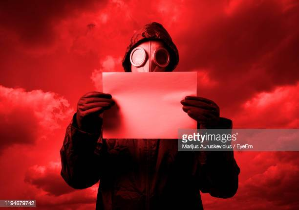 digital composite image of person holding camera - toxic substance stock pictures, royalty-free photos & images