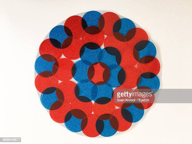 Digital Composite Image Of Red And Blue Circles On White Background