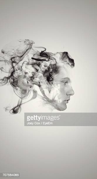 Digital Composite Image Of Smoke And Man Face Against White Background