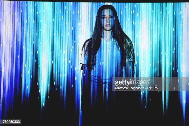 digital composite image of woman and illuminated blue lights - girl strips stock pictures, royalty-free photos & images