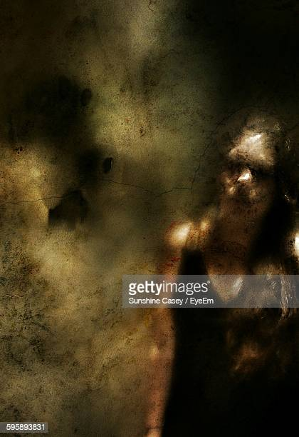Digital Composite Image Of Woman And Wall With Reflection On Mirror