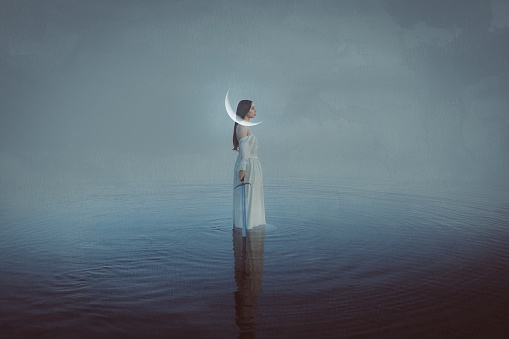 Digital Composite Image Of Woman Holding Sward While Standing In Sea Against Sky - gettyimageskorea