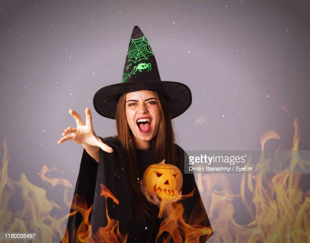 Digital Composite Image Of Woman Screaming By Fire