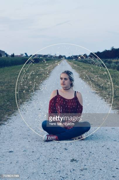 Digital Composite Image Of Woman Sitting By Constellation Circle On Footpath