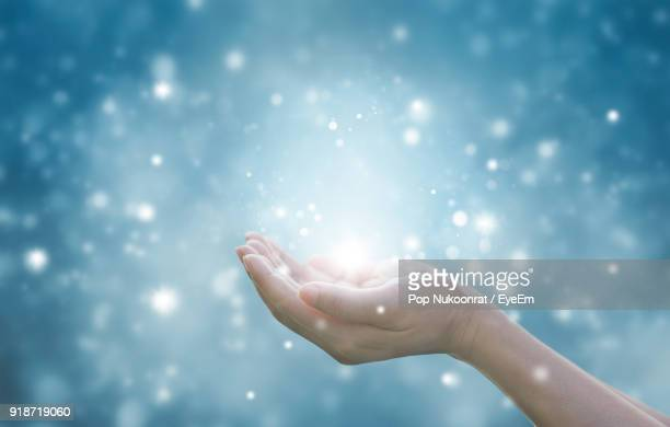 digital composite image of woman with glitter - hands cupped stock pictures, royalty-free photos & images