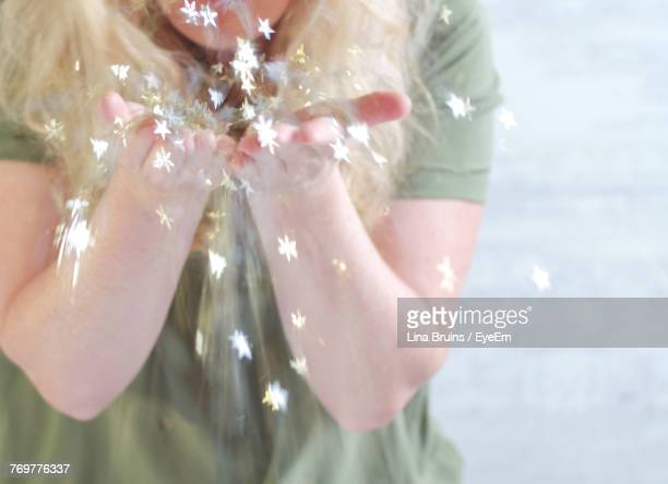 digital composite image of woman with star shapes flying - flying solo after party bildbanksfoton och bilder