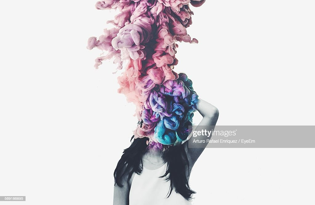 Digital composite image of young woman face covered with colorful fabric : Stock Photo