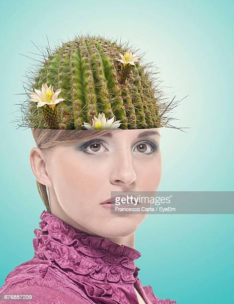 Digital Composite Image Of Young Woman Wearing Cactus