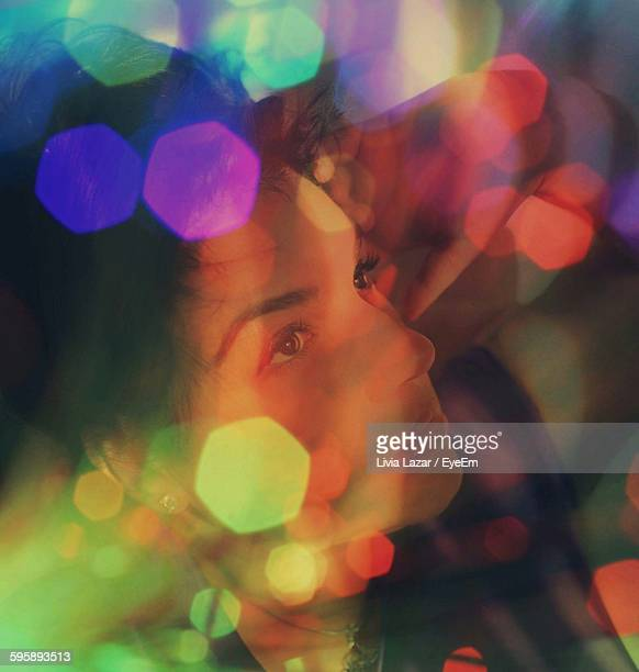 Digital Composite Image Of Young Woman With Colorful Lens Flare