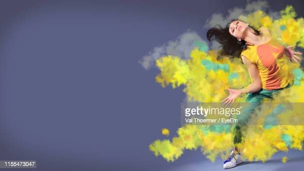 digital composite image woman dancing against colored background - デジタル合成 ストックフォトと画像