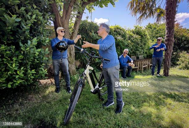 digital composite of a man preparing for bicycle training, france - cloning stock pictures, royalty-free photos & images