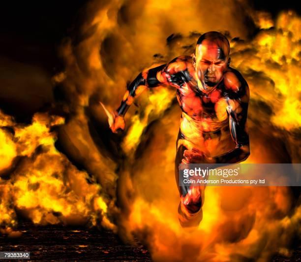 Digital composite of Asian man running in fire