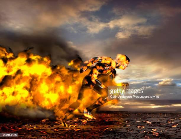 Digital composite of Asian man running on lava