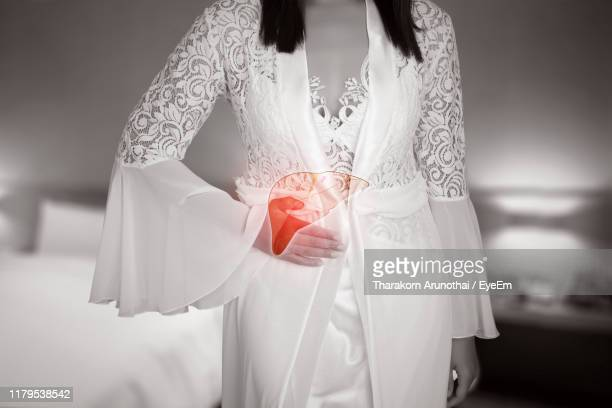 digital composite of bride wearing dress at home - cirrhosis stock pictures, royalty-free photos & images