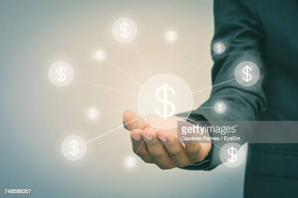 Digital Composite Of Businessman Holding Dollar Symbol