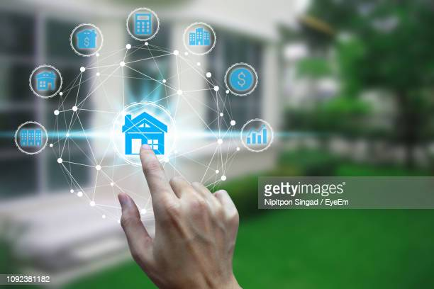 digital composite of cropped hand touching house symbol - house icon stock pictures, royalty-free photos & images