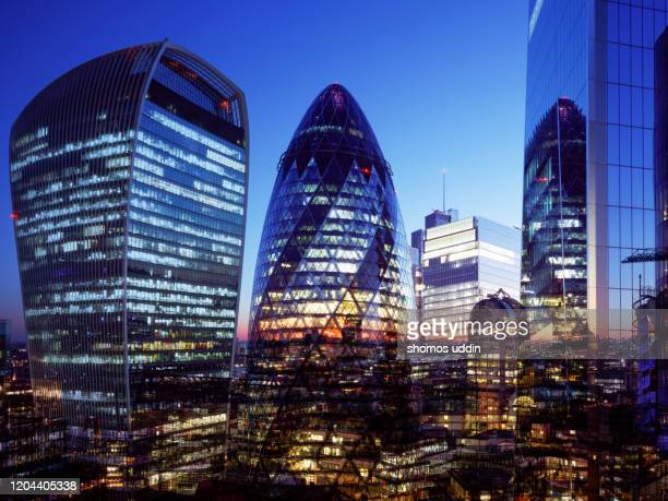 digital composite of futuristic skyscrapers in london city - illuminated stock pictures, royalty-free photos & images