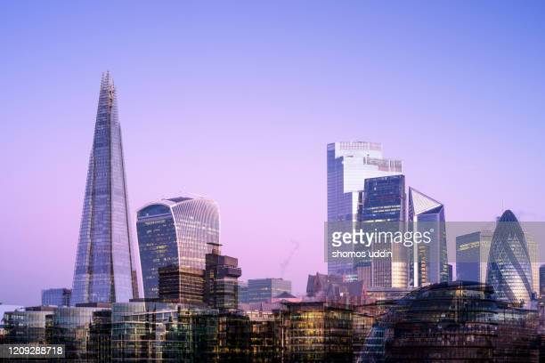 digital composite of futuristic skyscrapers in london city - skyline stock pictures, royalty-free photos & images