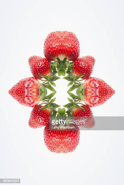A digital composite of mirrored images of an arrangement of strawberries