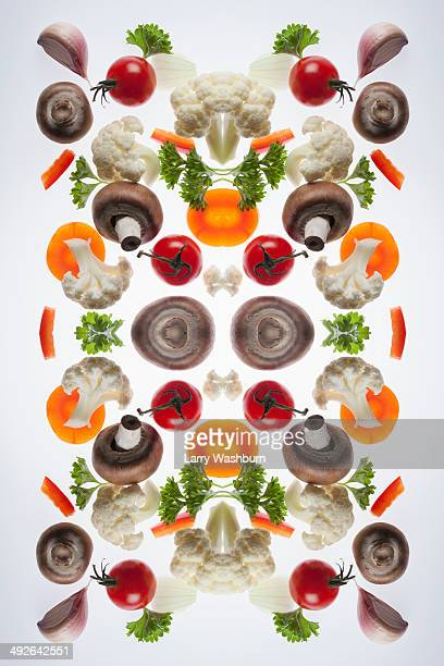 A digital composite of mirrored images of pieces of mixed vegetables