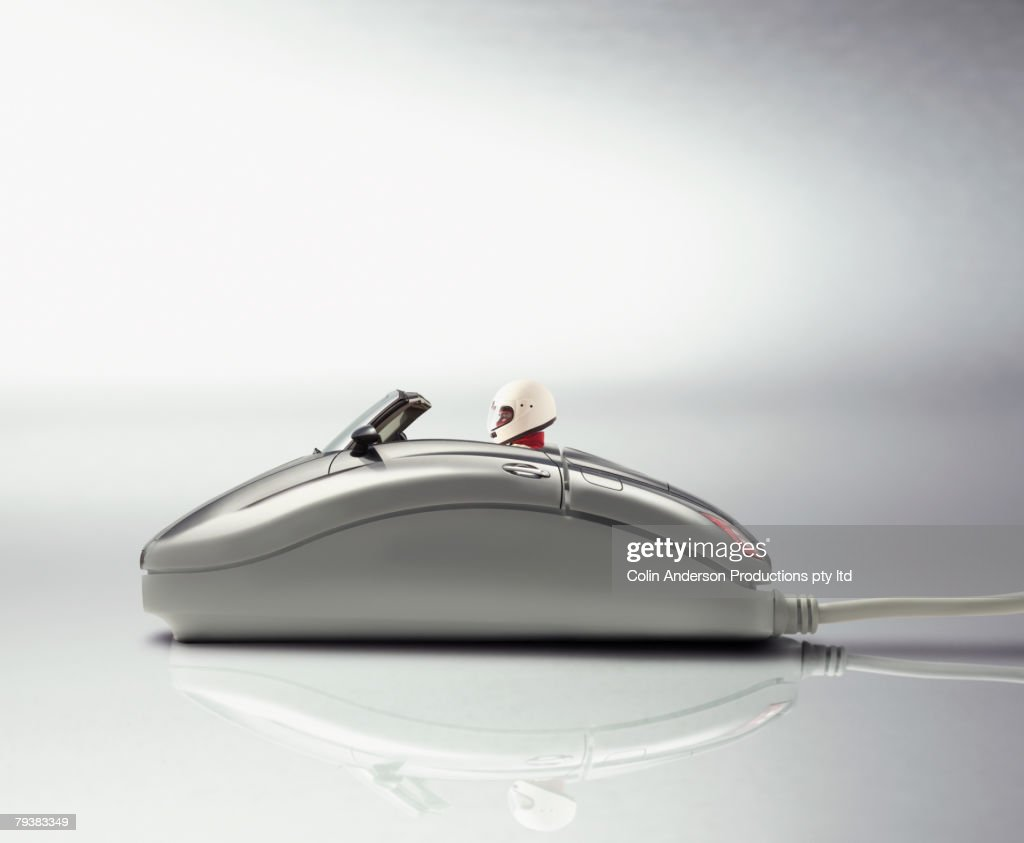 Digital composite of race car driver in computer mouse : Stock Photo