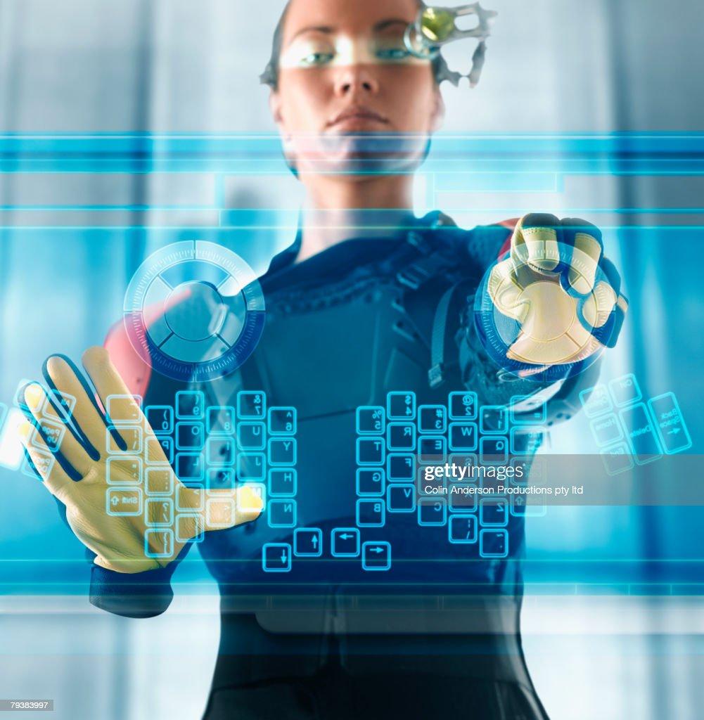Digital composite of woman using futuristic touch screen : Stock-Foto