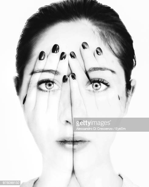 Digital Composite Portrait Of Young Woman With Hands On Face Over White Background