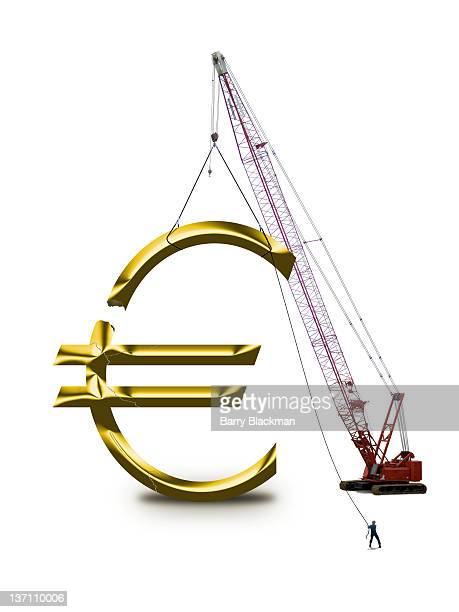 digital composite with crane lifting euro sign - barry crane stock photos and pictures