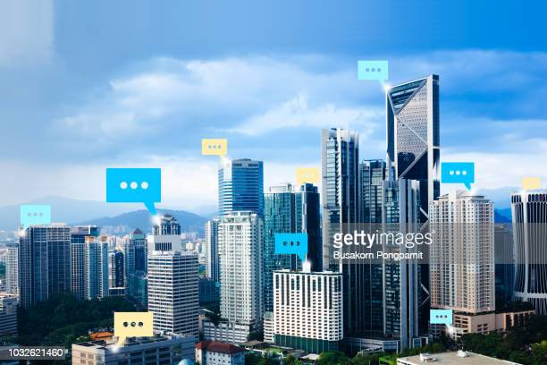 digital connection text on city background with bubble chat technology concept - twitter stock pictures, royalty-free photos & images