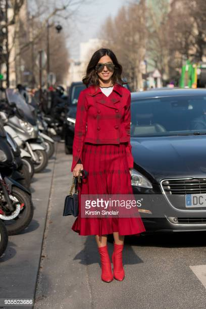 Digital content creator Luiza Sobral wears a Primart skirt and jacket, Dior bag and sunglasses and Balenciaga boots day 3 of Paris Womens Fashion...