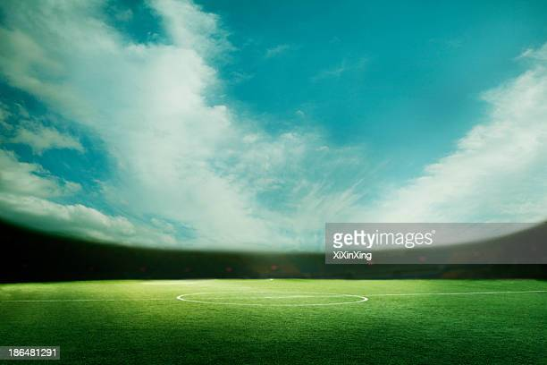 digital coposit of soccer field and blue sky - soccer scoreboard stock photos and pictures
