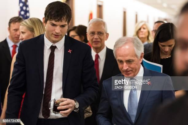 Digital Defenders of Children Founder Ashton Kutcher walks with Senate Foreign Relations Committee Chairman Sen Bob Corker before the start of a...