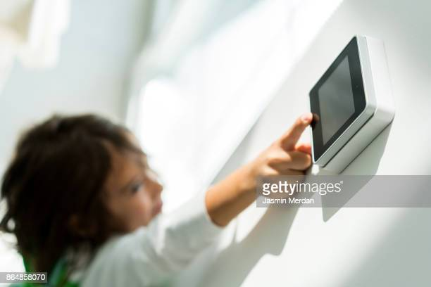 digital device high tech touch screen for smart home functions - premium access stock pictures, royalty-free photos & images