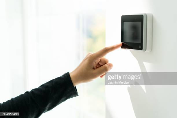 digital device high tech touch screen with icon for smart home functions - premium access stock pictures, royalty-free photos & images