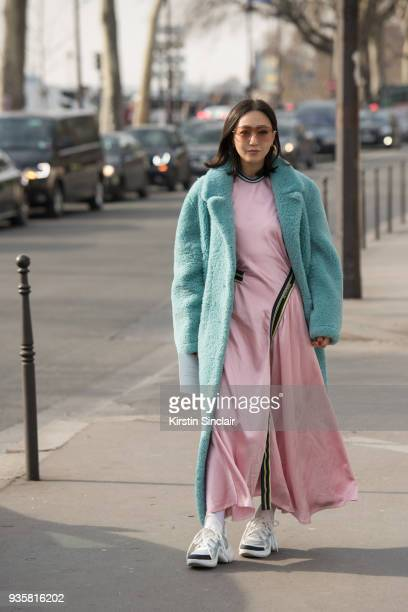 Digital director Vogue Korea Jiyoung Kim wears a Burberry coat Sportmax dress Louis Vuitton trainers day 3 of Paris Womens Fashion Week Spring/Summer...