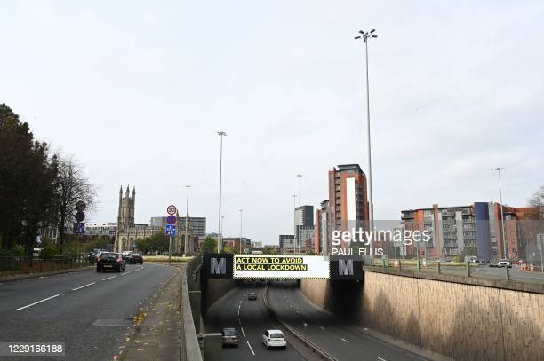 A digital display above a dual carriageway calls on residents to follow coronavirus guidelines in Manchester northwest England as the country battles...