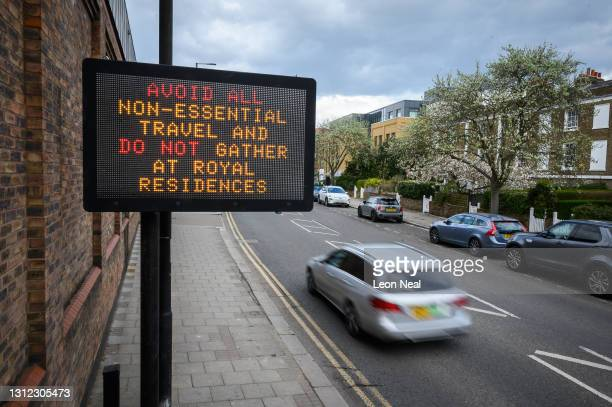 Digital display requesting that members of the public do not travel or gather at royal residences is seen as tributes continue to be made to Prince...