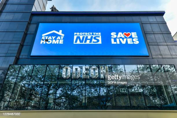 Digital display screen on the Odeon Luxe in Leicester Square showing a message saying Stay Home, Protect the NHS, Save Lives'. England has entered...
