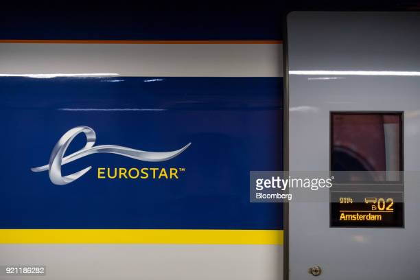 A digital display shows Amsterdam as the destination of a Eurostar International Ltd passenger train during the inauguration of the London to...