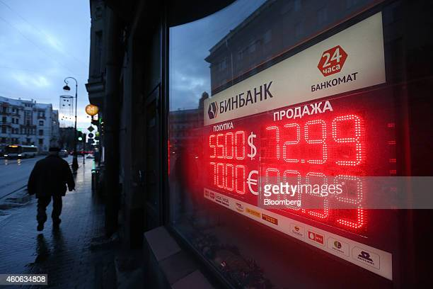 A digital display shows the latest US dollar and euro foreign currency exchange rate against the ruble outside a BB Bank JSC also known as Binbank...