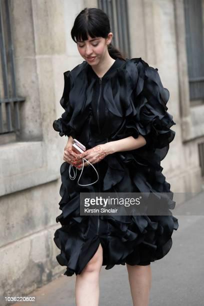 Digital Editor at Grazia Arabia Samantha de Reviziis wears an Anna Kiki dress during Haute Couture Fall Winter 2018/2019 on July 1 2018 in Paris...