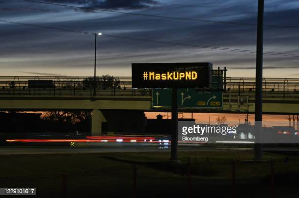 Digital highway sign encourages drivers to wear a mask in Fargo, North Dakota, U.S., on Wednesday, Oct. 14, 2020. The North Dakota Department of...