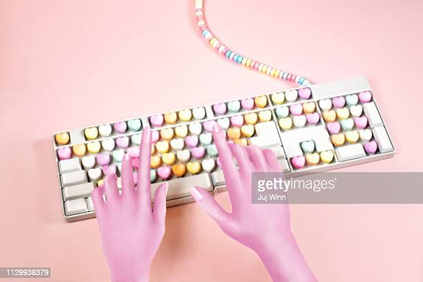 Digital illustration of hands typing on a candy keyboard
