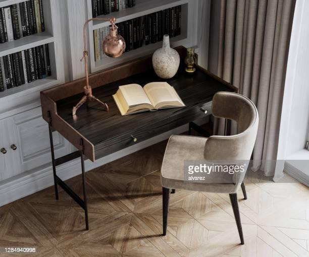 imagem digital de perto de uma cadeira e mesa com um livro aberto - mesa mobília - fotografias e filmes do acervo