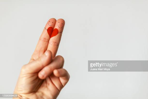 digital image composed of fingers with anthropomorphic face.  love concept.  valentine's day - things that go together stock pictures, royalty-free photos & images
