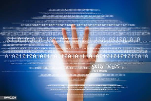 Digital image of hand and binary digits