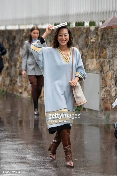 Digital Influencer Aimee Song wears a Loewe dress and bag with Paris Texas boots on March 01, 2019 in Paris, France.